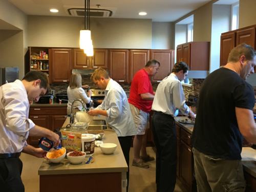 Pitzer Snodgrass employees cooking some great food for the Ronald McDonald House families!